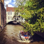 Bruge canal with river boat